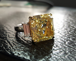 12.65 Carats Yellow Radiant Diamond with White Baguettes