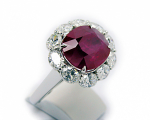 Oval Ruby with Oval Diamonds Halo Ring
